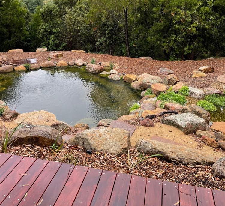 Water timber and stone landscaping